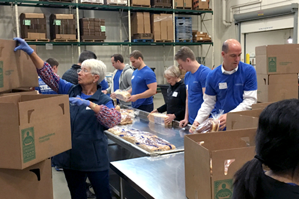 Chicago employees packaging food at the Greater Chicago Food Depository.