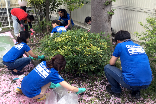 Tokyo employees beautifying a local park.